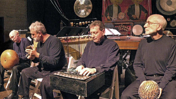 four men playing musical instruments