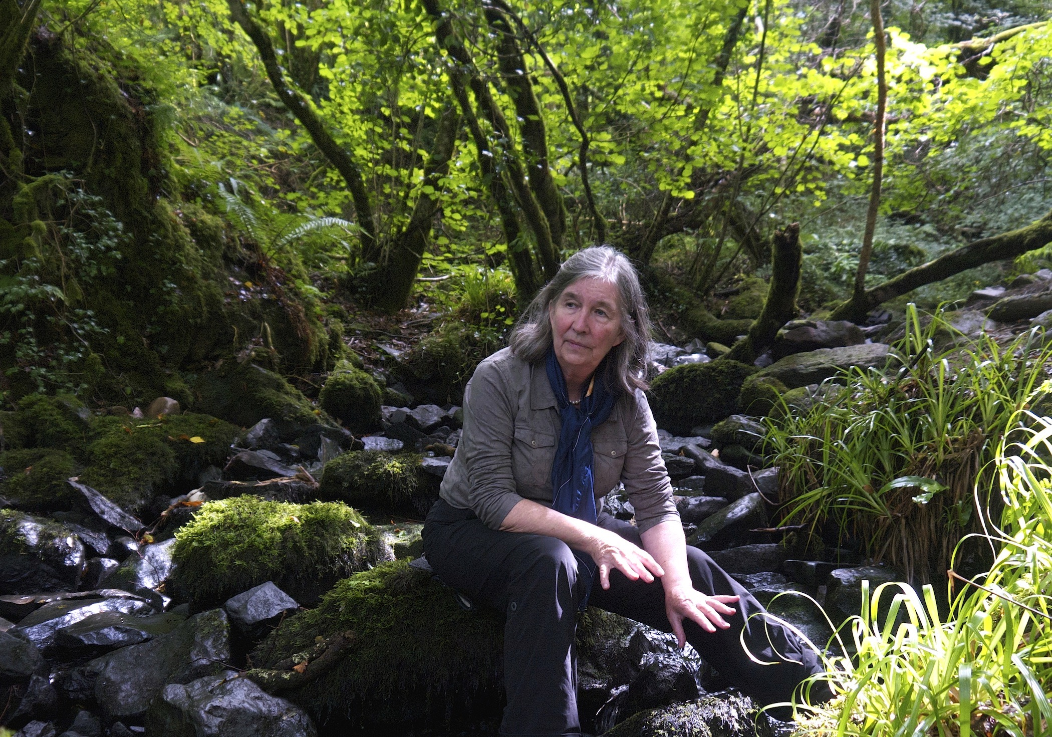 Photo of Diana in a forest with a stream